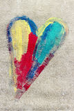 Colorful heart. Painted by a child on an asphalt Stock Images