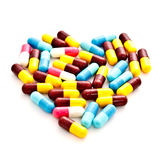 Colorful heart pill capsules Royalty Free Stock Photos