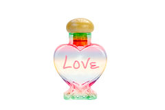 Colorful Heart shape bottles on background Royalty Free Stock Photo