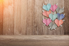 Colorful heart shape paper cut stick on old wooden background Stock Photo