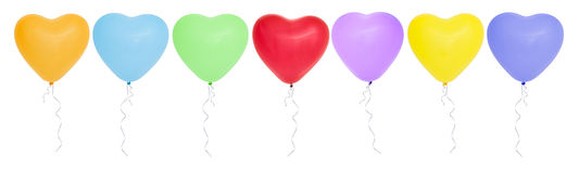 Colorful  heart-shaped balloons in a row. Stock Photos