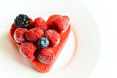Colorful heart-shaped cake Stock Photography