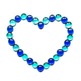 Colorful heart shaped frame. Made of semitransparent glass blue balls isolated on white Royalty Free Stock Image