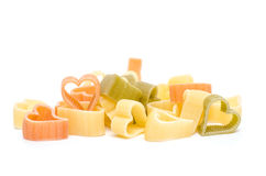Colorful heart shaped italian pasta Stock Images