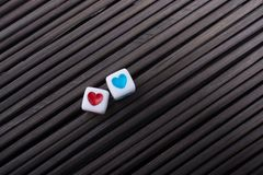 Heart shaped love cubes  on a straw mat. Colorful heart shaped love cubes  on a straw mat Stock Photo