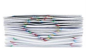 Colorful heart-shaped paperclip pile overload paperwork time lapse stock footage