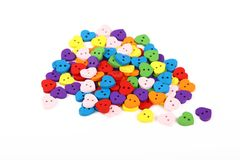 Colorful heart shaped sewing buttons over white Royalty Free Stock Image