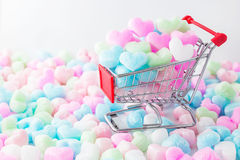 Colorful heart in shopping cart, love colorful foam heart. Royalty Free Stock Photography