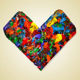 Colorful heart. A heart splashed with paint of different colors on a beige background with a retro effect Stock Image