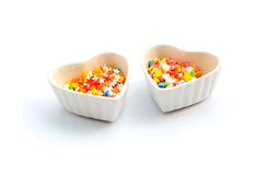 Colorful Heart and Star Cake Sprinkles and Cup white background Stock Photo