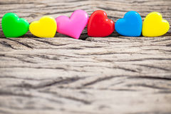 Colorful heart on the wooden for valentine background, vintage c. Olor tone royalty free stock photo