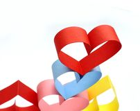 Colorful hearts. Colorful paper hearts on white stock image