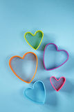 Colorful hearts on a blue background Stock Photo