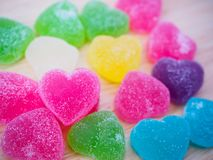 Colorful hearts candy on wood for valentines. Background stock images