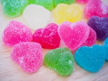 Colorful hearts candy on wood for valentines. Background royalty free stock image
