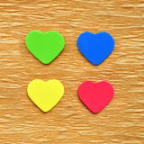 Colorful hearts cutout on crepe paper Stock Photo