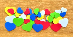Colorful hearts cutout on crepe paper Stock Photos