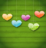 Colorful hearts hanging on green wooden texture for Valentine Da Stock Image