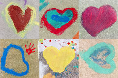 Colorful hearts. Painted by a child on an asphalt Stock Images