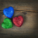 Colorful hearts over rustic wooden background
