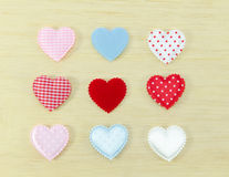 Colorful of hearts on wood background Stock Photos