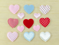 Colorful of hearts on wood background Royalty Free Stock Images