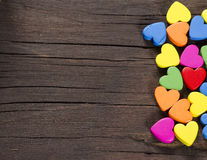 Colorful hearts on wooden background. Stock Image