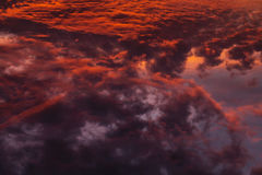 Colorful Heavenly Orange Clouds On Sky at Sunset Stock Image