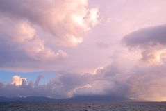 Colorful heavy clouds above sea Stock Photography