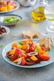 Colorful heirloom tomato and peaches salad Royalty Free Stock Images