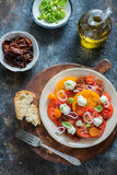 Colorful heirloom tomato salad Royalty Free Stock Photography