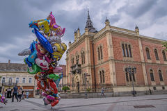 Colorful Helium Balloons and Bishops Palace in Novi Sad Royalty Free Stock Image