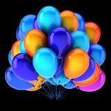 Colorful helium balloons bunch blue orange on black background. Colorful helium balloons bunch blue orange. balloon group birthday decoration multicolor glossy Royalty Free Stock Photos