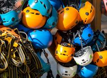 Colorful helmets for kids and adults in the rope park in summer at sunlights. Active sport royalty free stock photo