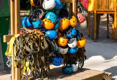 Colorful helmets for kids and adults in the rope park in summer at sunlights. Active sport. Lifestyle stock image