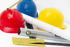 Colorful helmets and tools for construction drawings and buildin Stock Photo