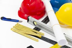 Colorful helmets and tools for construction drawings and buildin Stock Image