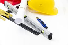 Colorful helmets and tools for construction drawings and buildin Stock Images