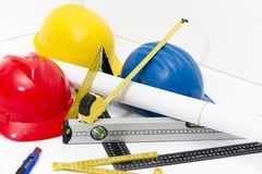 Colorful helmets and tools for construction drawings and buildin Stock Photography