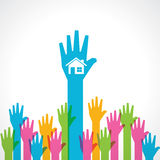Colorful helping hand with home icon Stock Photos