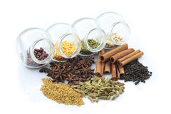 Colorful herbs and nuts. Colorful nuts in transparent glass storage and herbs Royalty Free Stock Photography