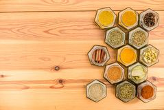 Herbs and spices with space for text on wooden background. royalty free stock photos