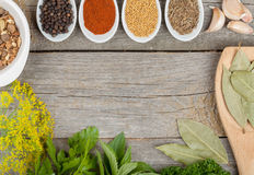 Colorful herbs and spices selection. Aromatic ingredients on wood table with copyspace stock photos