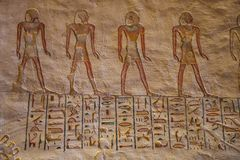 Colorful hieroglyphs in the tomb of Ramesses VII with painted figures