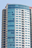 Colorful High Rise Condo Tower. A high rise condo complex rising into a blue sky Stock Photos