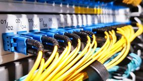 Colorful high speed optical fiber cables connected to the cloud network servers equipment switch inside modern big data center