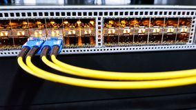 Colorful high speed optical fiber cables connected to the cloud network servers equipment switch inside modern big data center stock photos