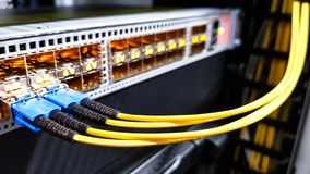 Colorful high speed optical fiber cables connected to the cloud network servers equipment switch inside modern big data center royalty free stock photo