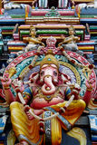 Colorful hindu statues on temple walls stock image