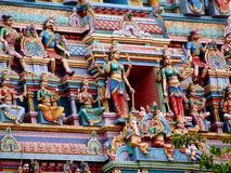 Colorful hindu statues on temple walls Stock Photography